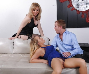Nina Hartley is instructing Britney Young how to blow..