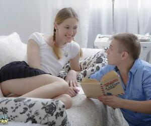 Youthful ash-blonde Inga wears white socks during..