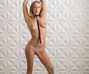 Youthful ash-blonde Vika P wears a neck corset and leash..