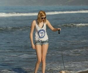Amateur honey Sloan Kendricks enjoys a day on the beach..