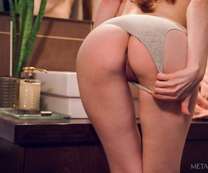 Flamy redhead jia lissa performs an titillating striptease..