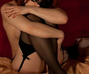 Nayul lays temptingly on the satin sheets with her legs..