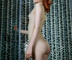 Pallid redhead Bella Milano shows her lean assets while..