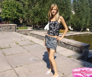 Youthful thin girl in short skirt removes her panties to..