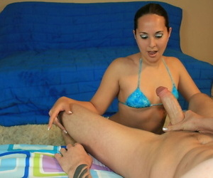 Small brunette in bikini gives a handjob and gets facialized