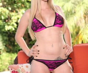 Ash-blonde dame Stacie Jaxxx sheds her string bathing suit..