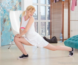 Flexible teenager Adelina does the splits before getting..