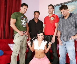 Teen dark-haired chick in the hardcore gang-bang groupsex..