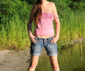 White teenage takes off jeans cut-offs to showcase her..