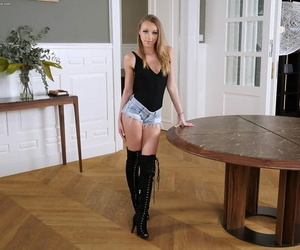 Teenager solo lady Angel Emily rails a dildo wearing black..