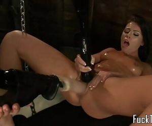 Busty stunner playthings pussy before sybian swing