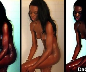Lean ebony caught while she takes a shower and masturbates..