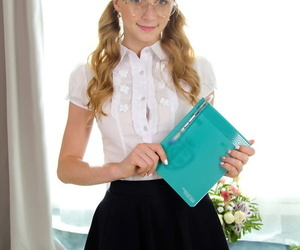 Nerdy schoolgirl Elizabeth Evans undresses cute panties..