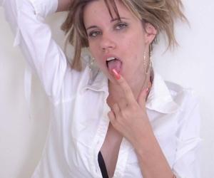 Horny babe in school micro-skirt Lily Saint sans bra legs..