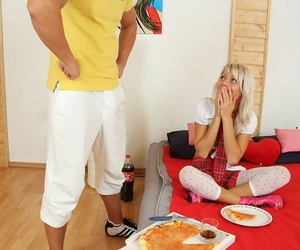 Youthfull blonde girl shares a pizza before getting..