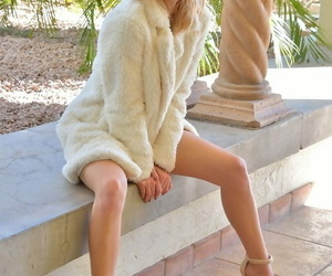 Delicious blond teenager demonstrating lovely legs and..