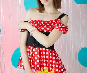 Petite young girl poses in the nude wearing Minnie Mouse..