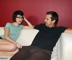 Geeky teenager Bailey gets nude while providing a hand job..