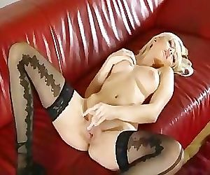A Blonde Chick On A Red Sofa