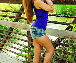 Sporty Asian strips outdoors and..