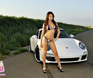 Shiny bikini hot on Asian car..