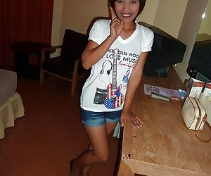 Asian cutie taking off her..