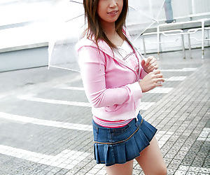 Seductive asian babe in miniskirt..