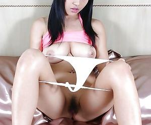 Busty asian babe with pigtails..