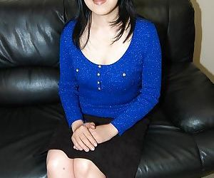Asian MILF with chubby curves..
