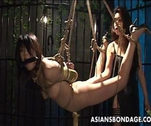 Bound Asian chick endures a nasty..