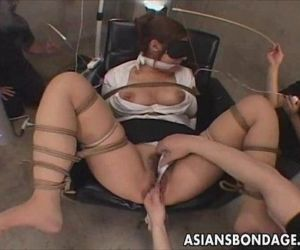 Japanese babe in bondage action -..
