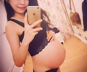 Pregnant asian in bra and panties