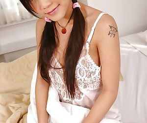 Asian babe Gigi masturbates her..