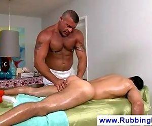 Masseur sticks his tongue in boys butt