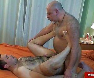 Horny daddy bear barebacking