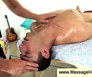 Gay masseur fucks dudes throat deep