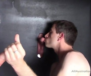 Two Good Looking Australian Boys Getting A Blow Job Through Glory Holes