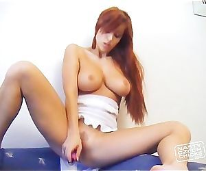 Ashley Robbins playing with dildo on the couch.