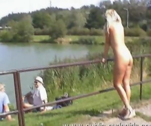 Sexy blonde walking naked around the lake