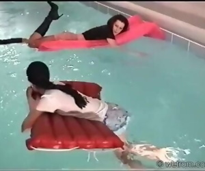 Skirts and Boots Swimming in Pool