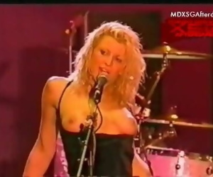 Holes Courtney Love in topless on stage at the Big Day Out 1999