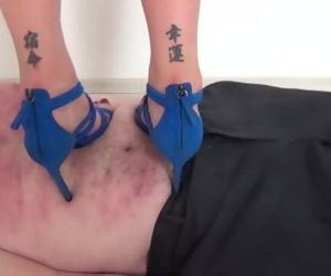 Zoe trampling in high heels