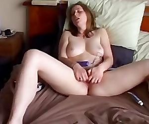 Paula masturbates to orgasm on a bed - hidden cam