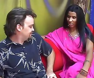 Young Indian lady gives an older man a blow job on a red couch 29 min