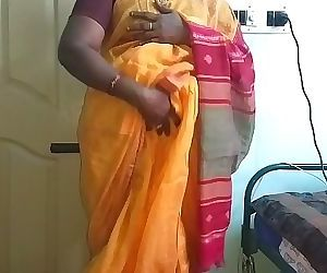 desi indian horny tamil telugu kannada malayalam hindi cheating wife vanitha wearing orange colour saree showing big..