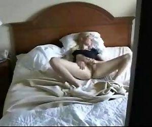 Caught my cute mom on bed fingering pussy. Hidden cam - 2 min