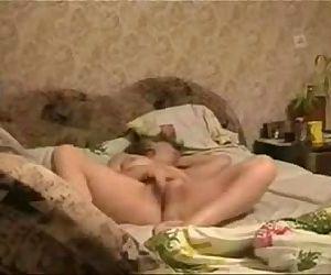 My horny mum masturbating on bed caught by hidden cam - 42 sec