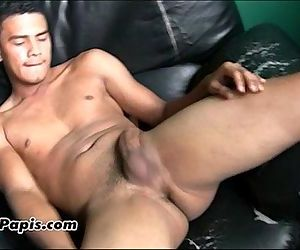 Hot gay latino guy strokes off his big uncut cock