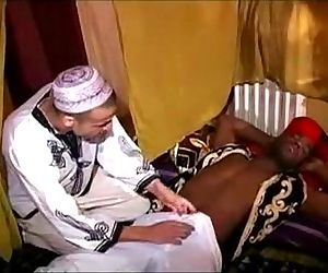 A top black guy is fucking a bottom arab boy !