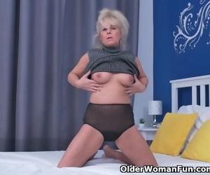 Euro GILF Koko Lowers her Jeans and Rubs her Vagina